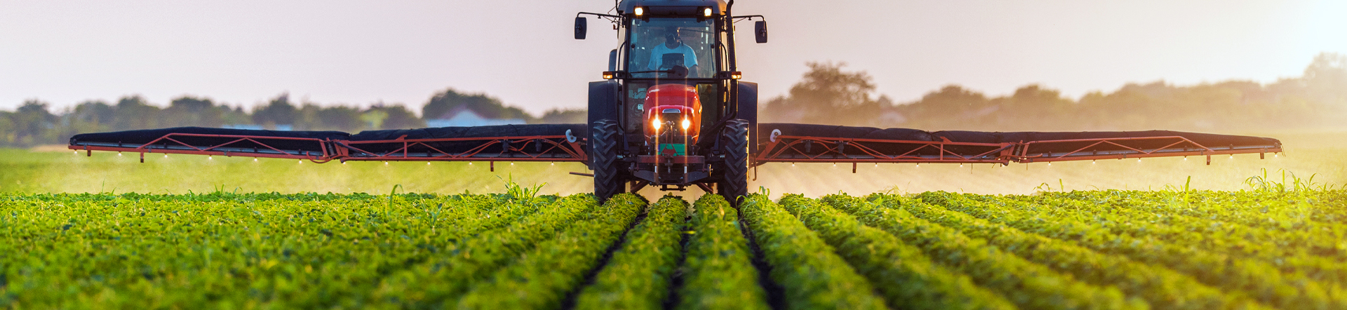 man in tractor spraying pesticides